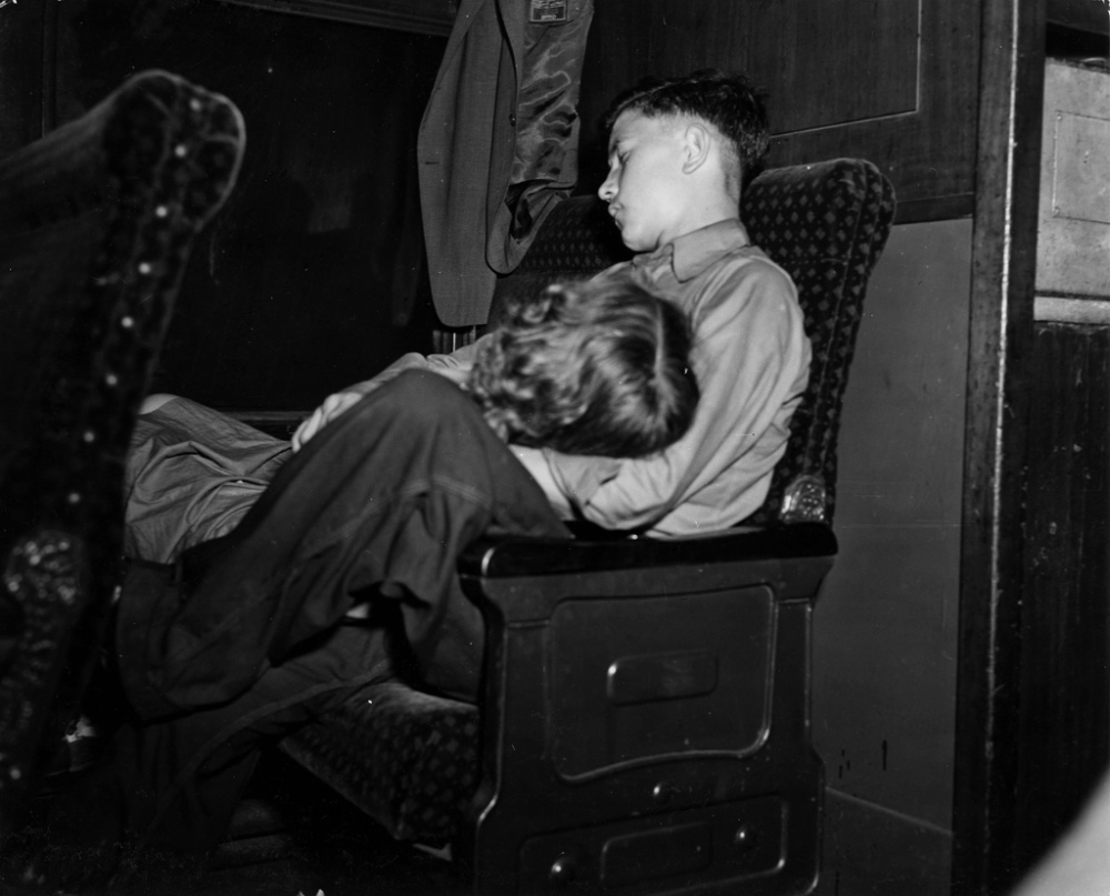 Boy and girl on their way to farm workers camp. En route to Batavia, New York from Richwood, West Virginia, 1942.